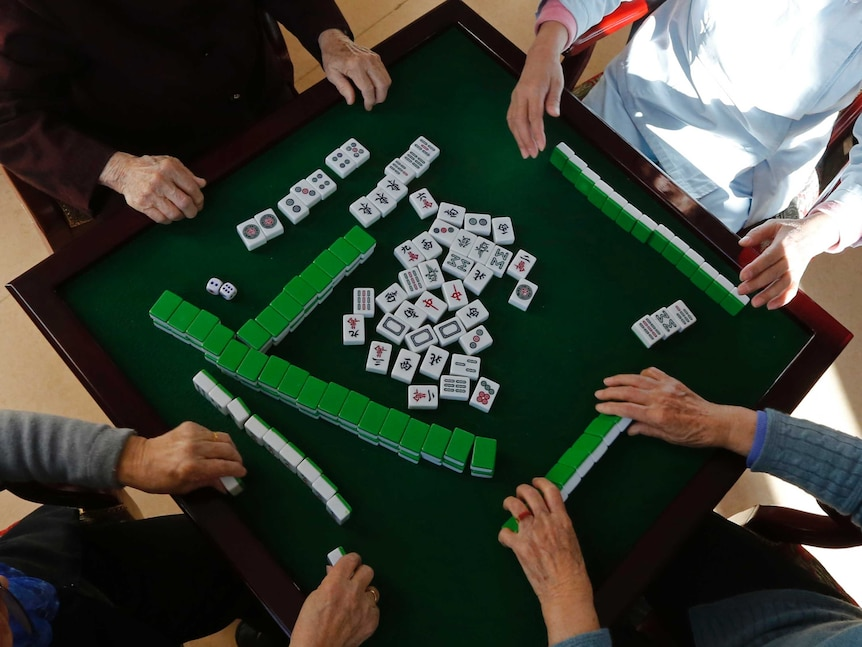 Mahjong tiles lay on the table.