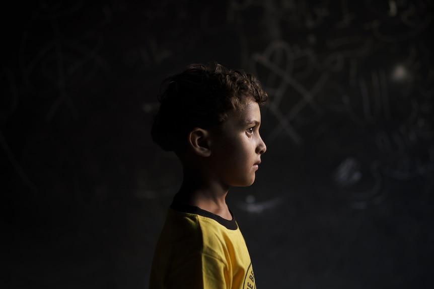 Qasim al-Masri, 6, poses for a portrait at his house in Beit Hanoun, northern Gaza Strip