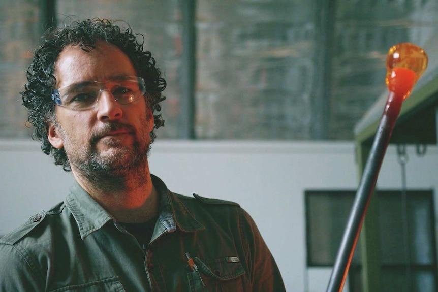 Tasmanian glass artist Keith Dougall looks at the camera.