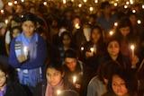 People hold candles at New Delhi vigil for gang-rape victim