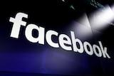 File photo shows the Facebook logo on screens at the Nasdaq MarketSite.