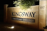 A shot of the gates of Kingsway Christian College at night.