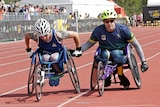 American Stephen Simmons helped by Mark Urquart at the Invictus Games.