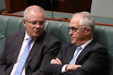 Malcolm Turnbull sits with his harms crossed listening to Scott Morrison in the House of Representatives
