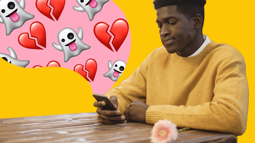Man sits and looks sadly at phone, which has cartoon ghosts and broken hearts streaming out, in a story about rejecting dates.