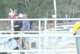 The man believed to have been reported missing returned to shore safely, escorted by a police officer.
