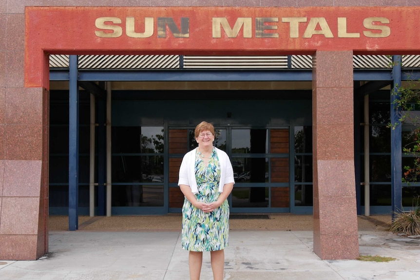 Kathy Danaher smiling in front of the Sun Metals building in Townsville