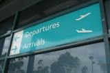 Arrivals and departures sign, Newcastle airport at Williamtown.