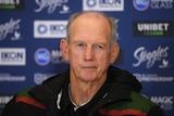 An NRL coach stares out at reporters at a post-match press conference.