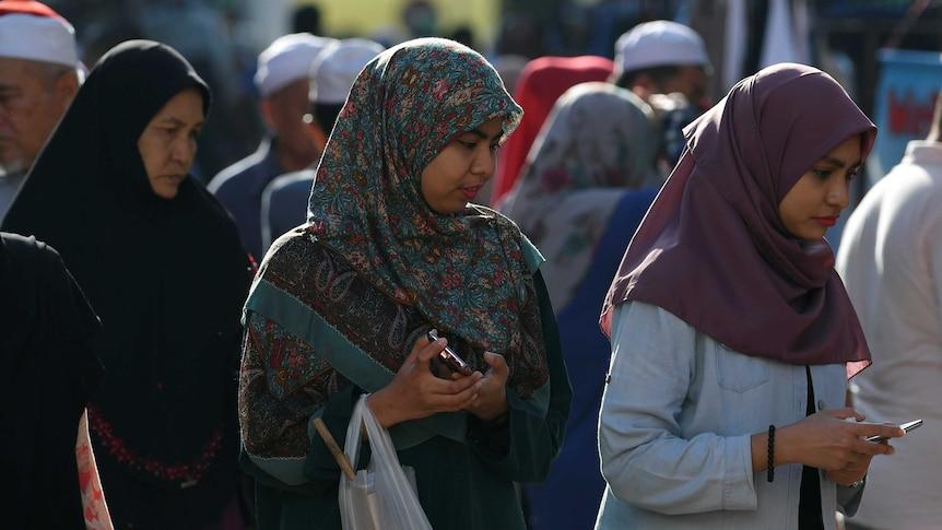 Muslim women wearing 'tudung' or headscarves shop in Kota Bharu, Kelantan, Malaysia