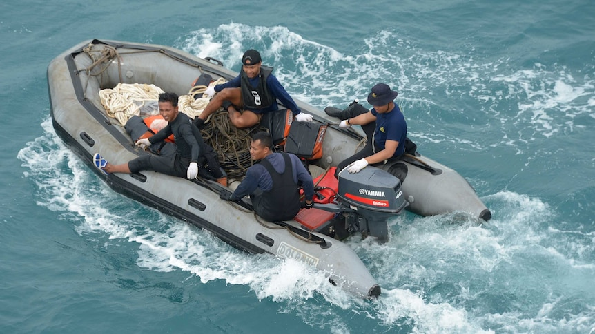 Indonesian navy divers on a motor boat in the Java Sea