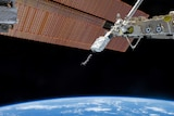 A picture of the earth and a satellite, from space