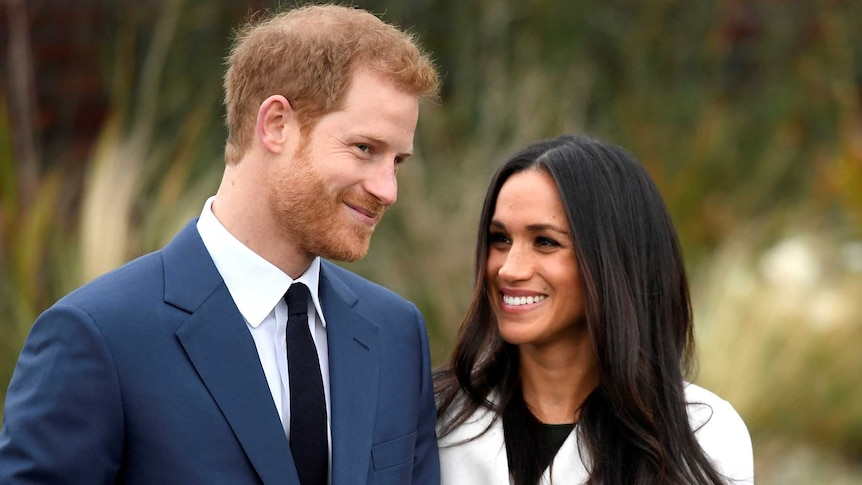 Prince Harry poses with Meghan Markle in the Sunken Garden of Kensington Palace.