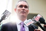 Craig Thomson speaks to the media at Parliament House.