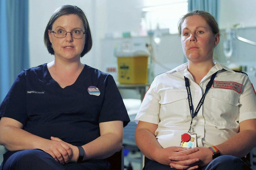 Ellen Anderson and Lauren Hepher sit next to each other in a hospital.