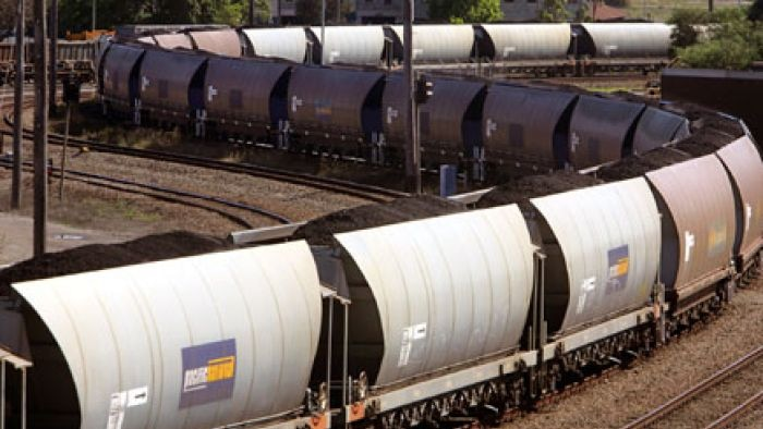 A coal train waits to be unloaded