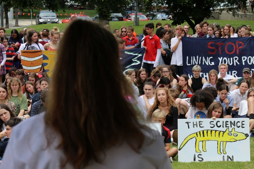 Students watch speaker at climate action rally, Hobart, 29 November 2018