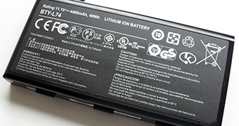 A black rectangular lithium ion battery with white writing on it.