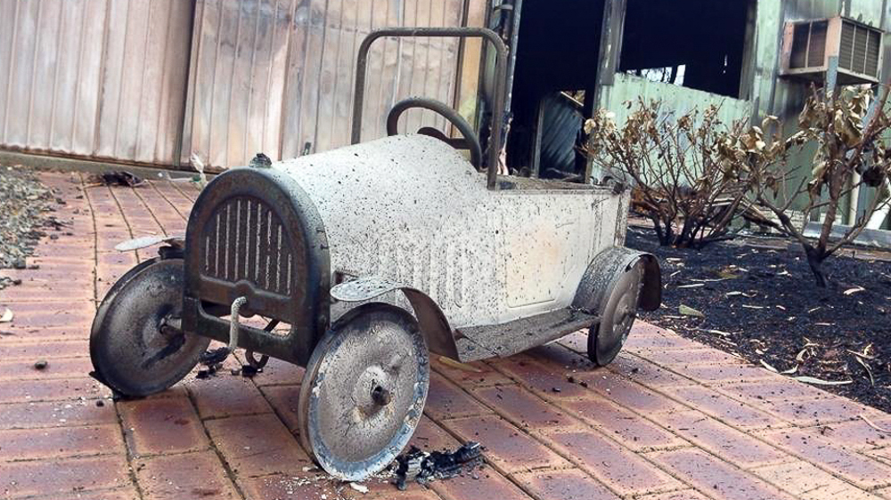 Eliza and Gracie's vintage pushcar was destroyed in the Sampson Flat bushfire.