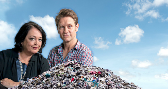 Promotional image of Wendy Harmer and Craig Reucassel standing near a pile of garbage for War on Waste