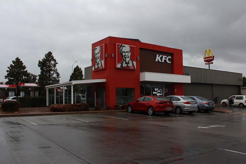 Rain clouds the view of KFC in Queanbeyan.