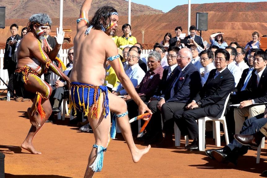 Japanese Prime Minister Shinzo Abe watches Aboriginal dancers.