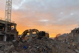 A digger sits on rubble at 10 Murray Street Hobart