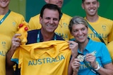Rio's mayor Eduardo Paes and Kitty Chiller, Australian chef de mission, pose at the Olympic village.