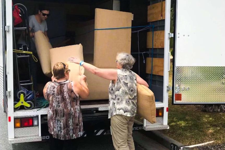 People moving furniture.