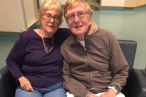 an elderly couple sitting a lounge