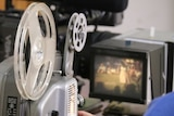 Salvatore Finocchiaro digitising his father's old 8mm films of Darwin life