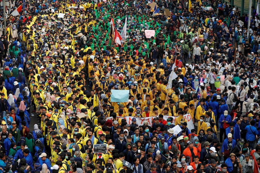 Tens of thousands of students in colourful university jackets hit the streets.jpg