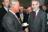 Prince Charles shakes hands with Gerry Adams