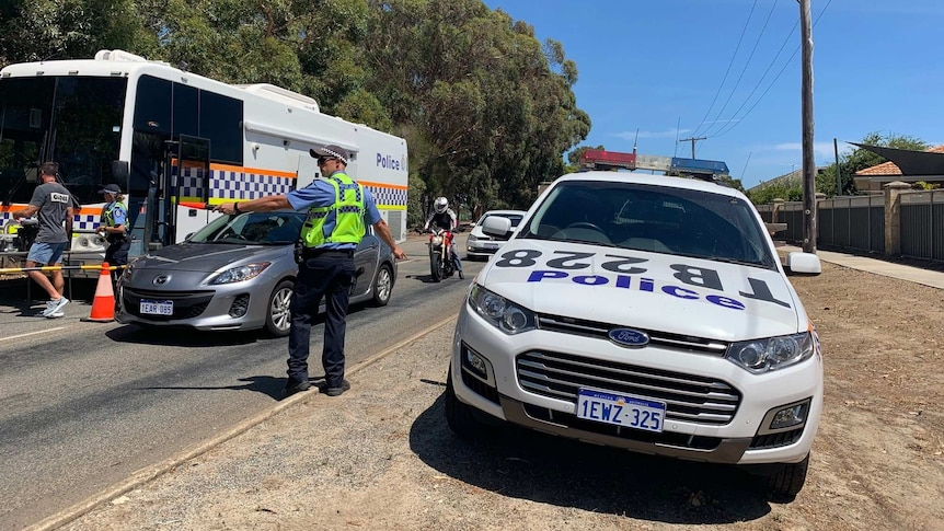 Police direct drivers into a drug testing van.