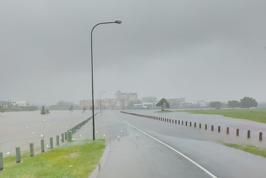 Flooding over a road.