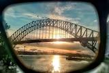 The Sydney Harbour Bridge seen through a pair of sunglasses.