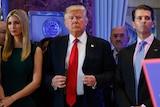 Donald Trump stands next to Allen Weisselberg, Ivanka Trump and Donald Trump Jr.