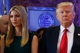 Donald Trump stands next to his daughter Ivanka Trump