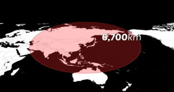 A black and white television graphic of a map shows the 6700km radius of North Korea's test thaad missile launch