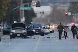 Law enforcement officials investigate