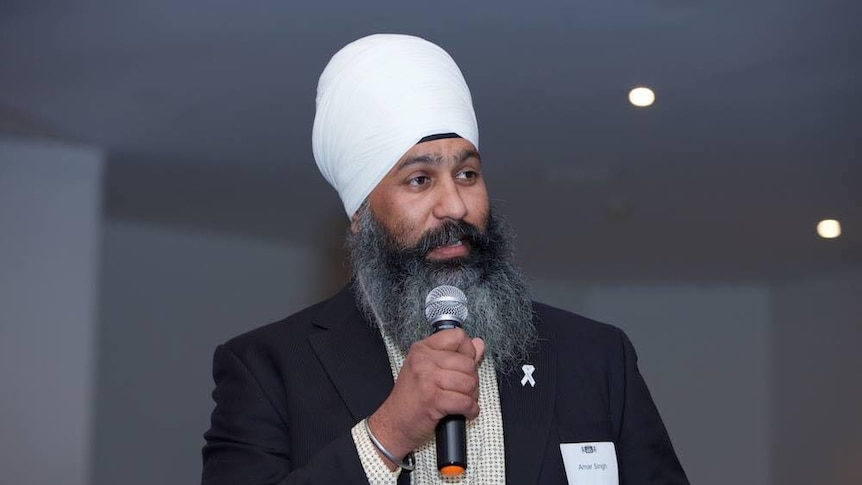 Turbans-4-Australia charity founder, Amar Singh speaks into a microphone
