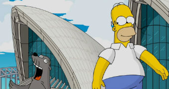 Homer Simpson stands outside the Opera House next to seal