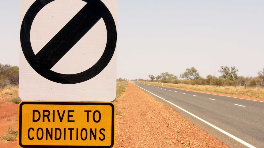 An image of an open speed limit sign on the Stuart Highway, north of Alice Springs
