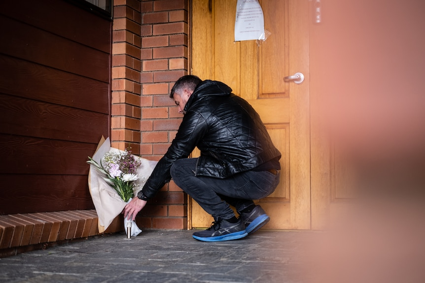 Bill Hahn leaving flowers at a Kingdom Hall in memory of the family he's 'lost' to the religion.