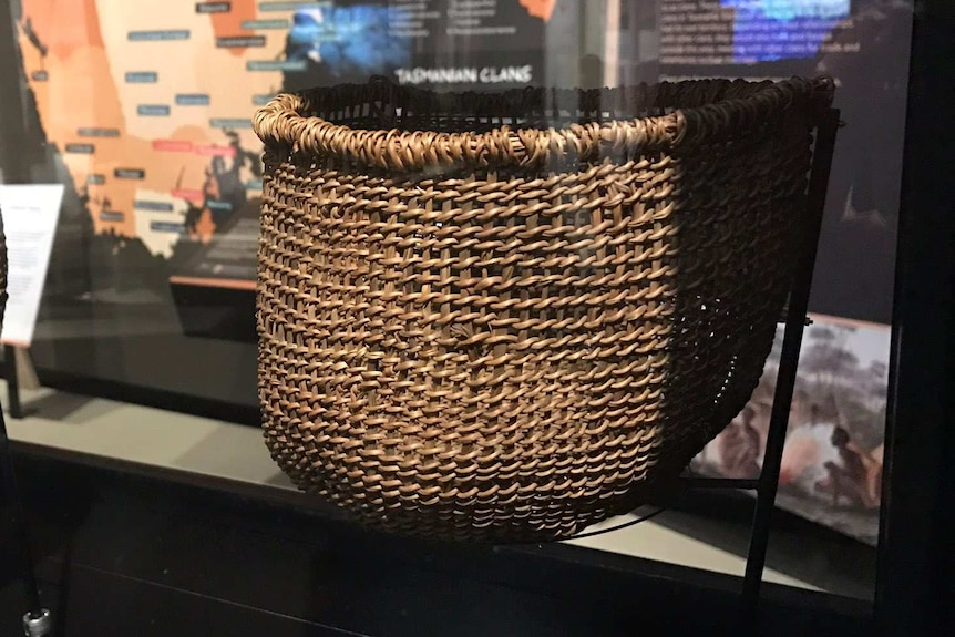 Woven basket on display at Aboriginal history exhibition.