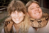 Terri and Steve Irwin with a snake wrapped around them