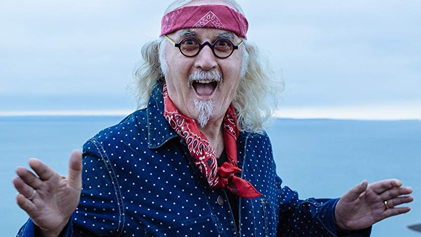 Billy Connolly smiling at the camera.
