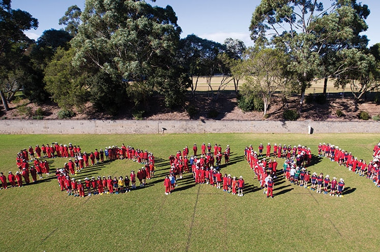 The Footprint group at Barker College spelling out the word sorry