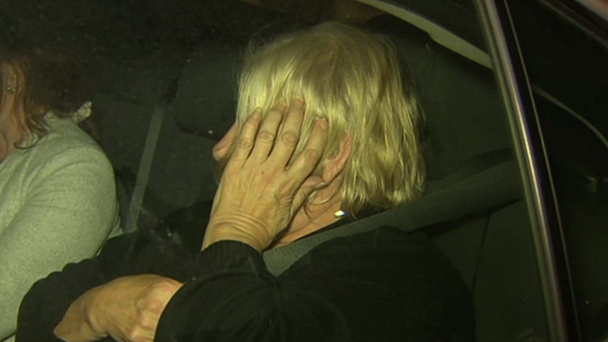 Disability care worker Rosemary Maione exits a car after her arrest.