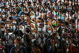 Crowds throng a vaccination centre in North Sumatra province on August 3, 2021.